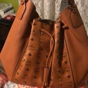 💯 Authentic MCM studded drew string handbag